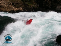 A kayaker punching through the Rebuffer Diagonal in Dynamite.